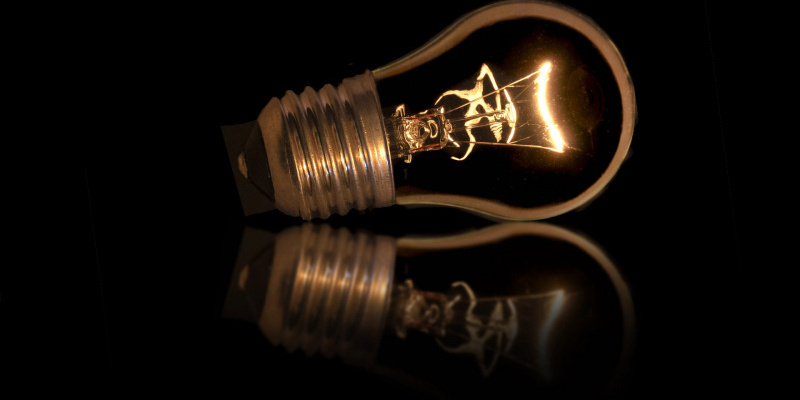 lightbulb-side-black-background